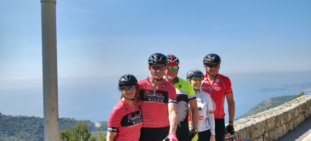 A guided group of cyclists on the Grande Corniche above Eze Village, guided by Azur Cycle Tours