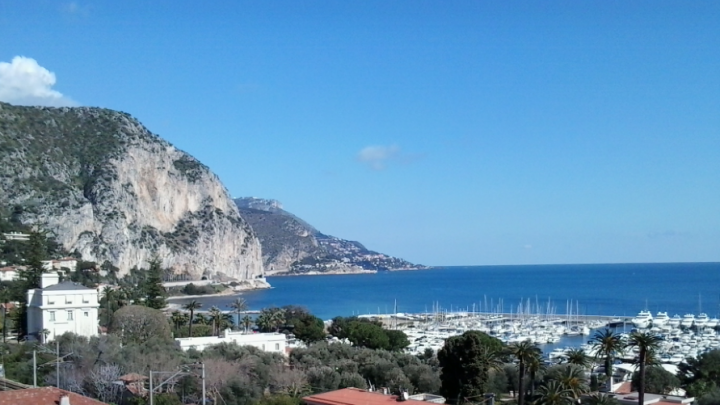 view from the apartment looking east to the cliffs of Beaulieu and Cap Roux beyond